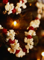 Cranberries and popcorn on a Christmas tree.