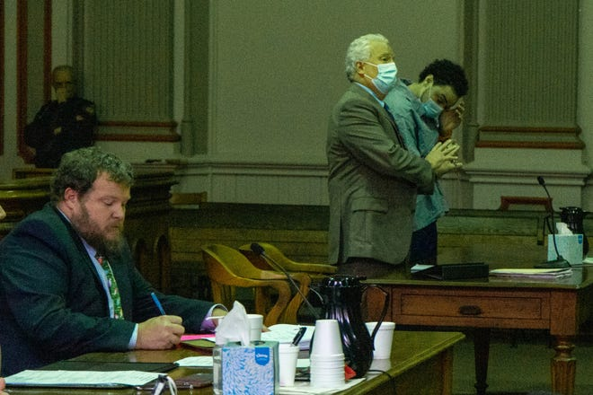 John Jenkins Jr. wipes away a tear at sentencing.