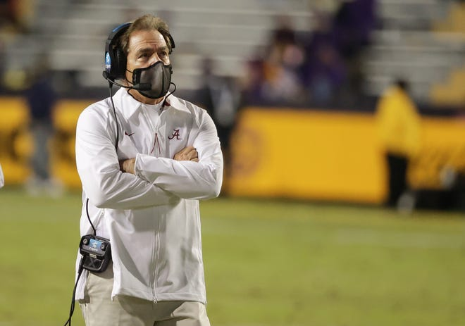 Like a masked thief, Alabama coach Nick Saban got two previous LSU commitments to sign with Alabama on national signing day on Wednesday.