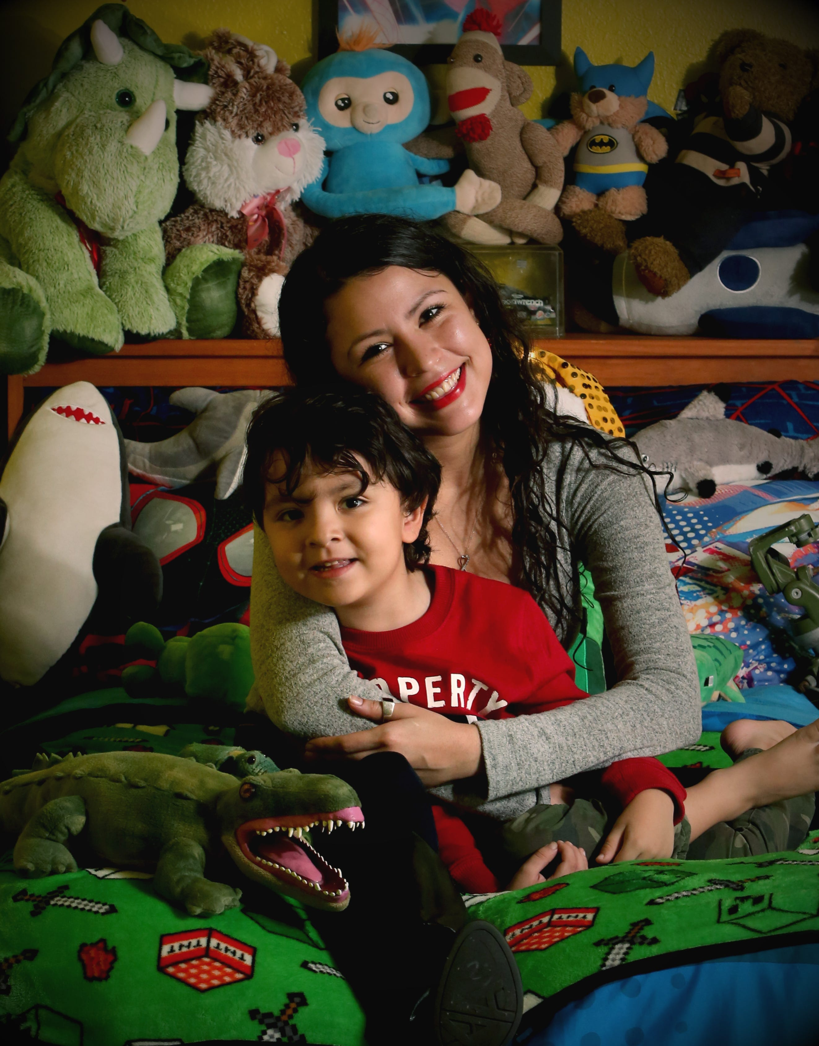 Ashley Burbach, 26, and her 4-year-old son, Cash, shown at their Ormond Beach home, were reunified in November.