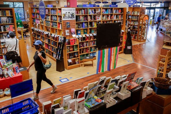 Customers browse for books at BookPeople on Dec. 10, 2020. Staff are encouraging customers to shop early for the holiday season this year, in order to get ahead of supply chain issues that may affect which titles are in stock.