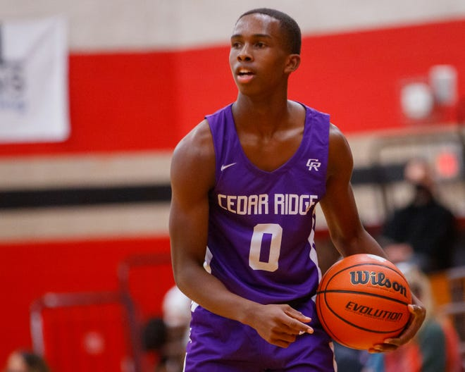 Cedar Ridge senior Earnest Swindell III, looking to pass against Bowie last week, said playing defense is his favorite part of basketball. He also said he likes to set up teammates for shooting opportunities.