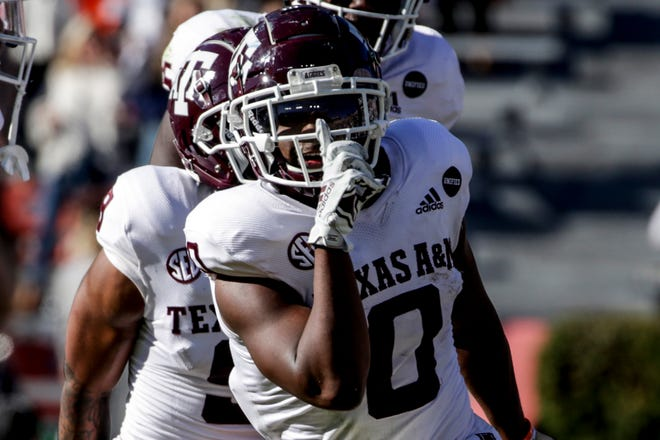 Texas A&M running back Ainias Smith celebrates after scoring a touchdown against Auburn on Dec. 5. The Aggies are No. 5 in the latest College Football Playoff rankings.