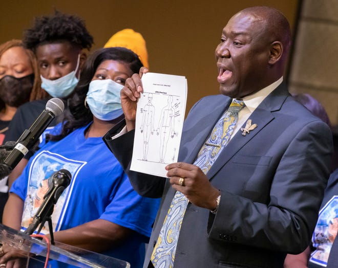 Lakeisha Feast and her family watch as attorney Benjamin Crump holds up the results of an independent autopsy of her son, Joshua Feast, at a press conference Wednesday night in Texas City.