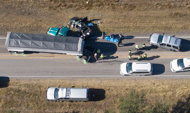 Law enforcement officers investigate a fatal wreck in the 12000 block of FM 1826, just south of the intersection with Texas 45 Southwest on Dec. 1. Two people were killed, authorities said.