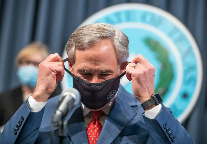 Texas Gov. Greg Abbott takes off his mask during a press conference on Sept. 17. [RICARDO B. BRAZZIELL/AMERICAN-STATESMAN]