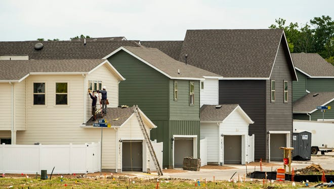 Houses are under construction in a Southeast Austin neighborhood earlier this year. The Austin metro area remains on pace for a record year in 2020, according to the Austin Board of Realtors.