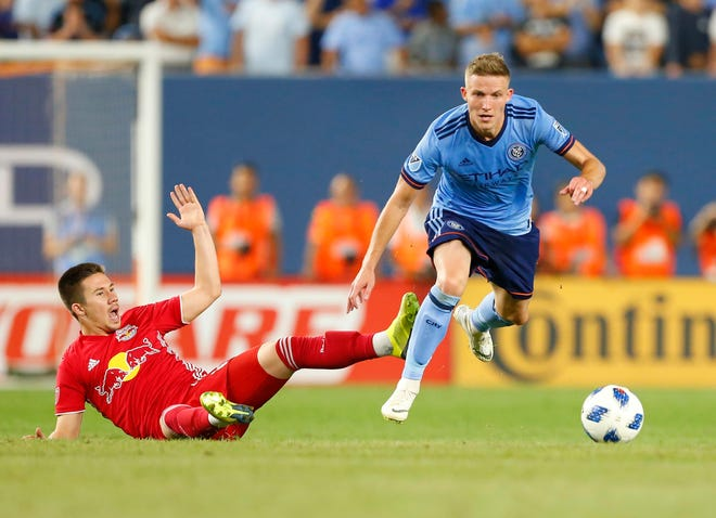 New York City FC midfielder Alex Ring plays the ball past New York Red Bulls midfielder Alex Muyl during a 2018 game. The former NYCFC captain was acquired by Austin FC Thursday for a possible $1.25 million in allocation money.