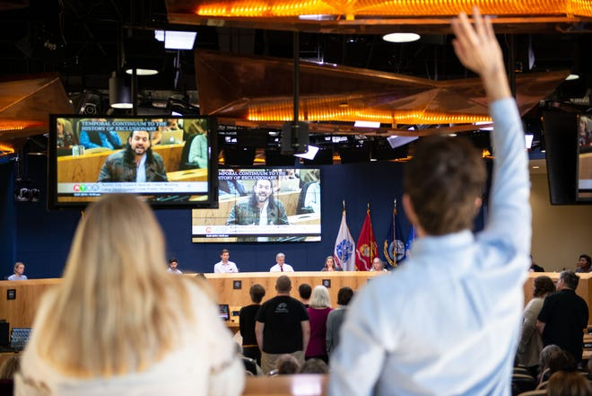 """Residents are shown waving their hands in support of speakers during a December 2019 hearing at Austin City Hall on proposed changes to the Land Development Code. A proposal to adopt a """"strong mayor"""" form of government would bring dramatic changes to City Hall."""