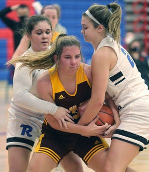 Walsh Jesuit's Megan Taraba is pressured by Revere's Emma Drushell, left, and Audrey Livesay during the second quarter of the Warriors' 56-48 win Wednesday night. [Phil Masturzo/Beacon Journal]