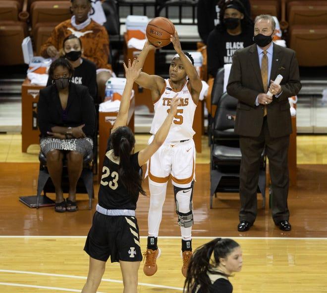 Texas guard Kyra Lambert shoots over Idaho's Gina Marxen at the Erwin Center on Dec. 9.