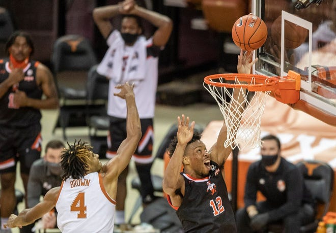 Sam Houston State's Tristan Ikpe scores a basked against Texas forward Greg Brown in the second half of Wednesday night's 79-63 Longhorns win. Eleventh-ranked Texas improved to 6-1.