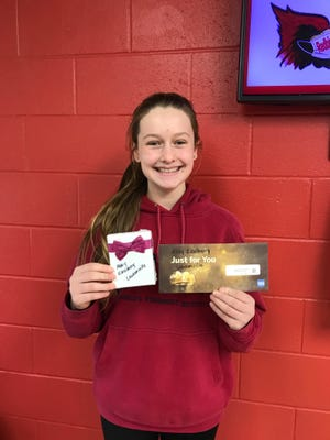 Emily Eikelberry with her gift cards from the Girls with Goggles program.