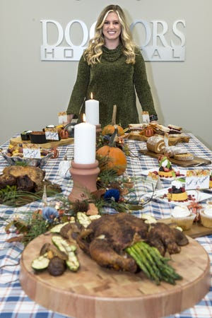 Lizzie Keen, clinical dietician at Doctors Hospital of Augusta, stands with a holiday spread tailored to smaller groups of people. [MICHAEL HOLAHAN/THE AUGUSTA CHRONICLE]