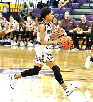 Merryville's Mekyah Hooper (with ball) scored 17 points in a win Tuesday over South Beauregard.