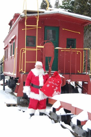 Little ones in the community please know that Santa Claus WILL make his annual rounds Friday night delivering toys and packages to Barnesville area homes! While many special events and activities have been curtailed in 2020 rest assured Santa will not be deterred by a virus. In this photo, Santa is checking out things at the historic Barnesville B & O Depot caboose. Merry Christmas to Enterprise readers near and far!