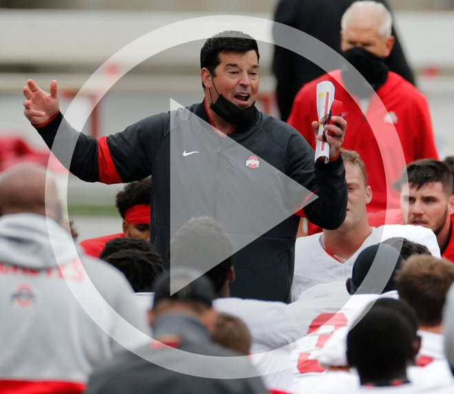 In this Saturday, Oct. 3, 2020, file photo, Ohio State head coach Ryan Day talks to his team during their NCAA college football practice, in Columbus, Ohio. As Alabama, Ohio State, Clemson, Oregon, Notre Dame, Oklahoma and Florida prepared to play for conference championships, they signed top-10 recruiting classes for 2021 they hope to fuel their next title contenders..
