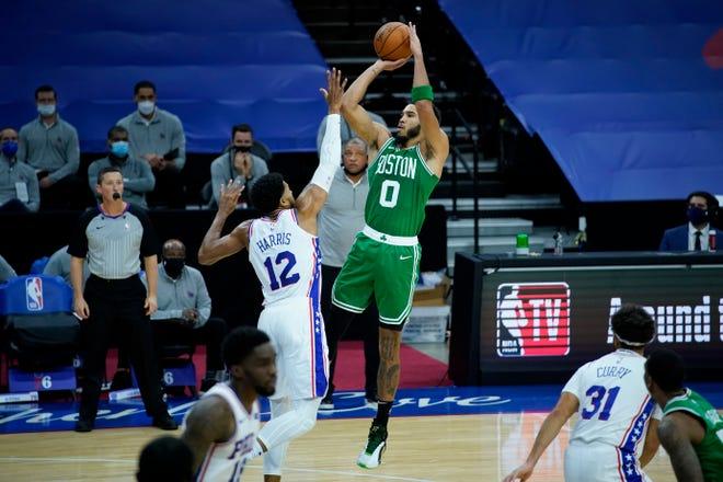 Boston Celtics' Jayson Tatum (0) goes up for a shot against Philadelphia 76ers' Tobias Harris (12) during Tuesday's preseason game in Philadelphia.