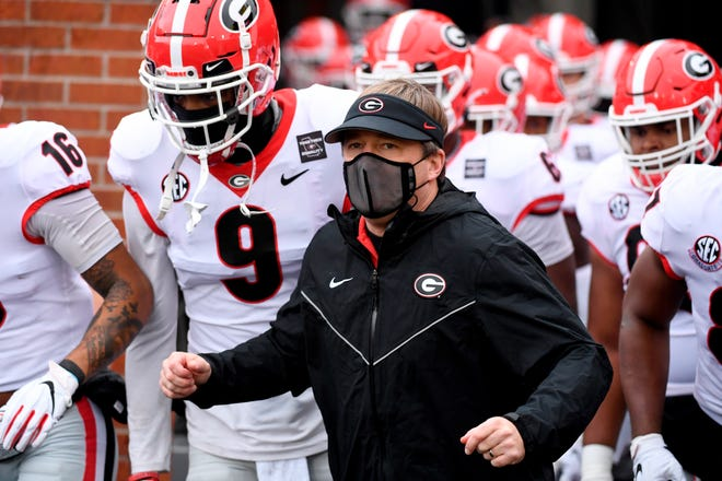 Georgia head coach Kirby Smart is seen before the start of Saturday's game against Missouri in Columbia, Mo.  Smart said the personal touch that helps coaches sell their programs to blue-chip prospects is missing from this year's recruiting cycle due to restrictions brought about by the coronavirus pandemic.