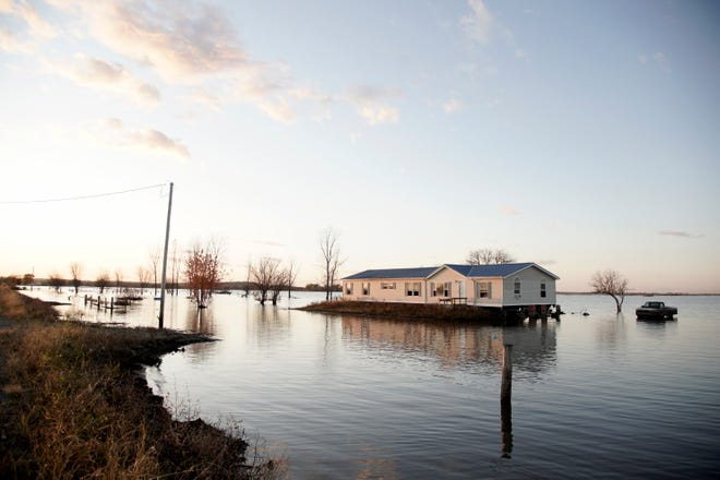 A home is surrounded by Missouri River floodwaters in Bartlett, Iowa, in Oct. 2019. A judge has ruled that the federal government must pay landowners on the lower Missouri River for flooding damage caused by the Army Corps of Engineers' efforts to protect endangered species.