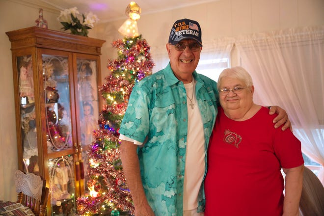 Don and Janet Sansone stand in front of their Christmas tree at their home in Tavares.