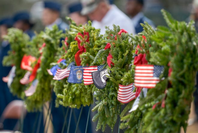 Wreaths honoring service members and their families are displayed at a wreath laying event at Lone Oak Cemetery in Leesburg on Saturday, Dec. 16, 2017. [PAUL RYAN /CORRESPONDENT]