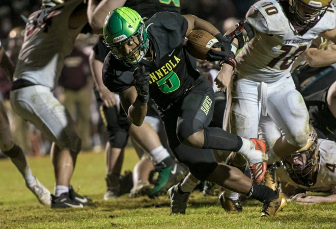 Lake Minneola's Duke Walker (5) scores a touchdown in triple overtime at the Class 6A state semifinal game last week against St. Augustine. The win propelled the Hawks in the Class 6A state finals, where they will play defending champions Miami Central. [PAUL RYAN / CORRESPONDENT]