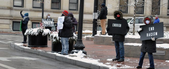 A group of protesters gather on East Liberty Street in downtown Wooster Thursday. It marked the 200th consecutive rally since the death of George Floyd in late May.