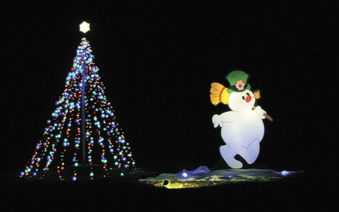 Frosty the Snowman walks around as a Christmas lights create a tree in this decorated area of Woodland Park Christmas Lights in the Park. This year's display opened Monday and will continue from 5:30-8 p.m. every night through Dec. 26. Lights will also be featured at Fairview Park this season.