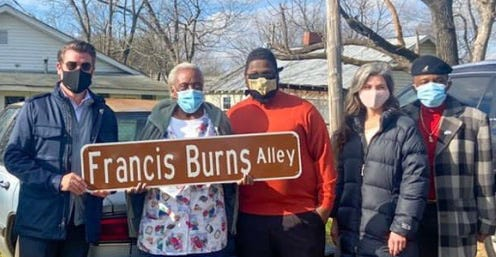 Francis Burns holds the honorary street sign for the alley next to her house off of Cotton Grove Road, where she has lived for 45 years. Also pictured is Lexington Mayor Newell Clark (left), Burns, and Lexington City Council members Garett Holloway, Whitney Brooks and Donald Holt.