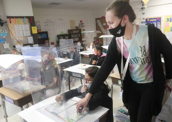 Teacher Jenny Haney moves through her classroom checking on the students, Wednesday December 16, 2020, as the class works on a science assignment at Pine Trails Elementary School in Ormond Beach.