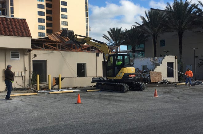 Demolition crews work on the former senior center in Daytona Beach Shores,  the future home of Halifax Health's new urgent care center. The facility will be the only beachside urgent care center.