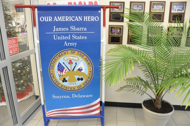 The banner from the Town of Smyrna honoring Army veteran James Sbarra is on display at Atlantic Apothecary. Banners honoring the veterans selected by the mayor and council members for the 2020 Veterans Day proclamation are also on display at the Smyrna Diner, Bridge Way Restaurant, Trevi Restaurant, The Painted Stave, Guzzy Q Restaurant and Smyrna Cards and Gifts.