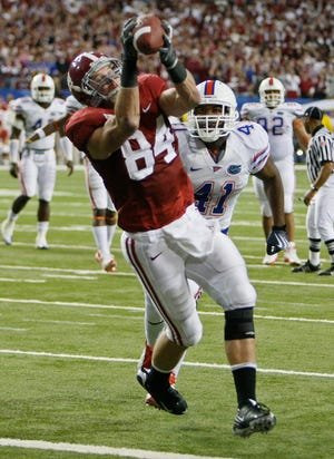 In the 2009 SEC Championship game, Alabama tight end Colin Peek (84) hauls in a 17-yard touchdown pass as Florida linebacker Ryan Stamper pursues from behind. It gave 'Bama a 26-13 lead en route to a 32-13 Tide victory that eventually led to a national championship and building of a dynasty under coach Nick Saban.