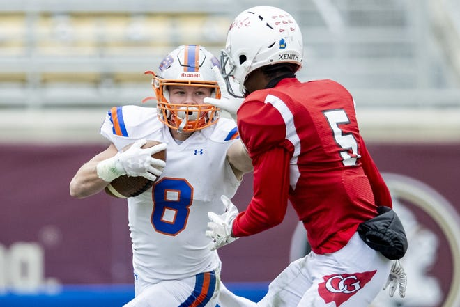 Bolles running back Kade Frew (8) rushes for yardage against Cardinal Gibbons during the Class 4A football championship.