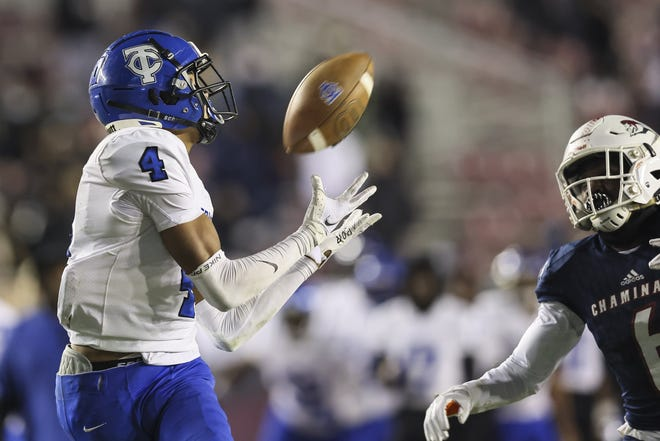 Trinity Christian wide receiver Marcus Burke (4) catches a touchdown pass in the fourth quarter of the Class 3A state championship against Hollywood Chaminade-Madonna. Burke, a University of Florida signee, is among a multitude of Power Five signees from Duval County in the past five years.