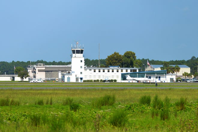 A view of the Cecil Airport control tower from across the runways.
