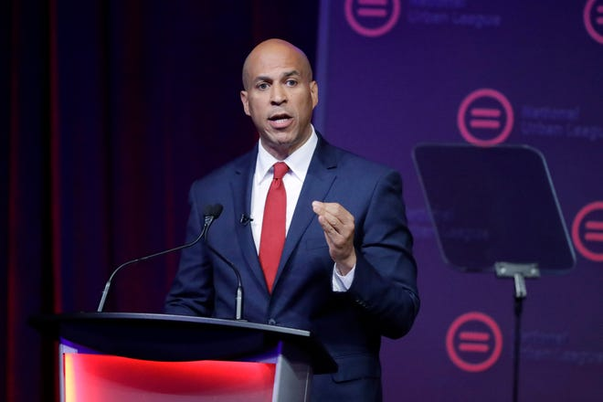 Then-Democratic presidential candidate Corey Booker speaks during the National Urban League Conference  in Indianapolis, in this Thursday, July 25, 2019, file photo. A bill being introduced Thursday, by four Democratic lawmakers would grant college athletes sweeping rights to compensation, including a share of the revenue generated by their sports, and create a federal commission on college athletics. If passed the College Athletes Bill of rights could wreak havoc with the NCAA's ability to govern intercollegiate athletics, and the association's model for amateurism.