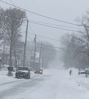 Snow falls on Conant Street in Gardner on Thursday morning as the nor'easter continues to batter Greater Gardner.