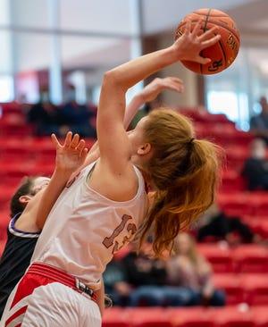 Glen Rose's Abby Stephenson takes the ball hard to the basket in Glen Rose's 65-23 win over Tolar on Saturday.