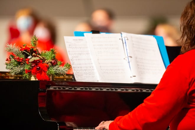 A pianist performs for a choir during a Christmas concert in Glen Rose, Texas.