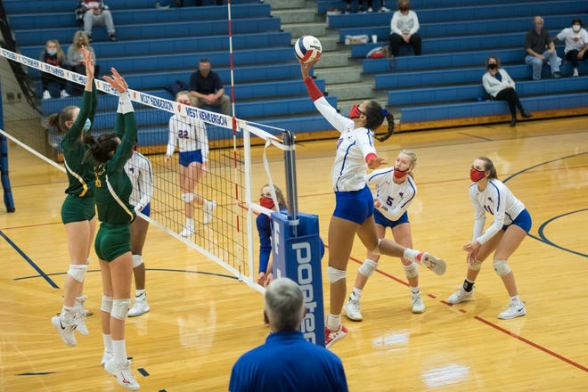 West Henderson's America Anderson stretches for the hit against AC Reynolds on Tuesday night at West.