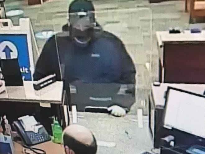 Police are searching for a suspect seen on video during a report of an armed robbery at about 5 p.m. Dec. 15 at HomeTrust Bank at 1825 Hendersonville Road in Asheville.