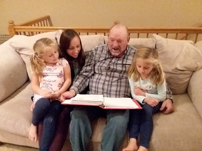 Brad Hopkins shares family history with his daughter and grandchildren.