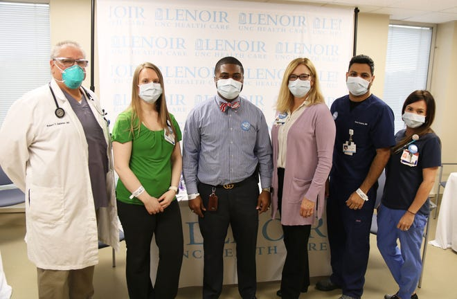 Dr. Rob Gallaher, Jessica Cunningham, Kinston Mayor Dontario Hardy, Dr. Claire Paris, Dr. Varun Chukka, and Brandy Burd pose at UNC Lenoir Health Care Thursday, Dec. 17, after being the first people in Lenoir County to receive the Pfizer vaccine.