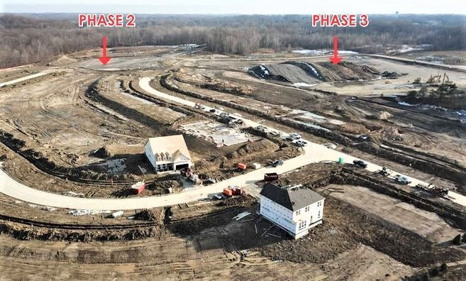 This aerial view shows construction progress at Phase 1 of the Renaissance Park at Geauga Lake west subdivision, plus the locations of Phases 2 and 3. The view is from Squires Road. The abandoned railroad tracks run across the top, while Treat Road is at the upper right.