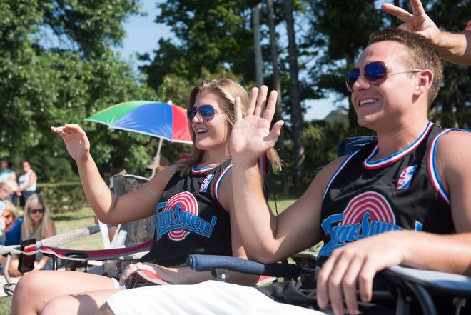 Jillian Sosnak (left) and Josh Sosnak (right) wave to the participants in the Twins Days parade in Twinsburg in 2018. The 2020 Twins Days was canceled due to the COVID-19 pandemic. It is scheduled to return in 2021, with the theme The Roaring Twinties.