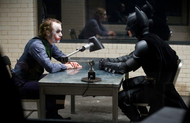 "This image released by the Library of Congress shows Heath Ledger, left, and Christian Bale in a scene from the 2008 film ""The Dark Knight."" The film was added to the National Film Registry."