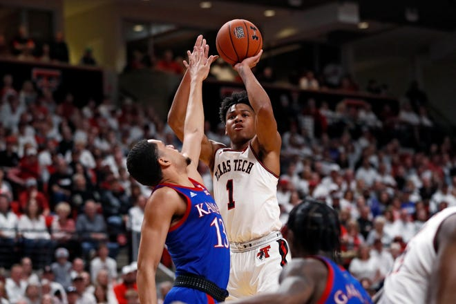 Kansas forward Tristan Enaruna (13) contests a shot by Texas Tech guard Terrence Shannon (1) during the Jayhawks' 66-62 victory March 7 at United Supermarkets Arena. The two teams square off again Thursday night in Lubbock for a Big 12 opener. (AP Photo/Brad Tollefson)