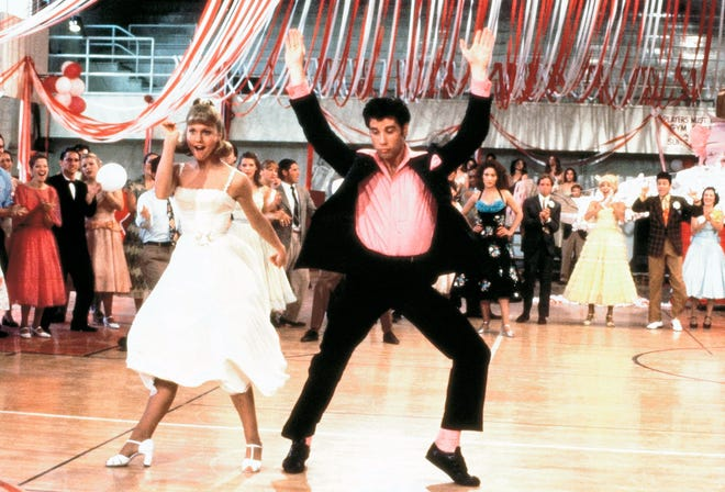 "This image released by the Library of Congress shows Olivia Newton John, left, and John Travolta in a scene from the 1978 film ""Grease."" The film was added to the National Film Registry."